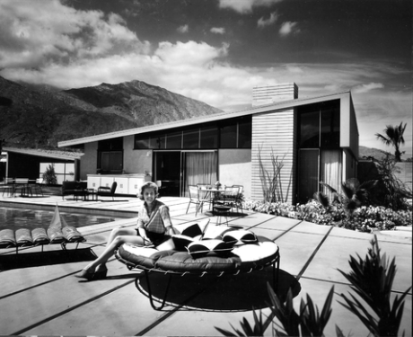 """A backyard advertising photo of """"Smoke Tree Valley"""" subdivision (now known as Twim Palms), designed by Bill Krisel and Alexander Construction Company's first development in Palm Springs."""
