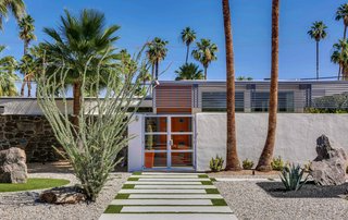 This updated 1957 home in the Twin Palms Estate features the subdivision's signature palm trees front and center.