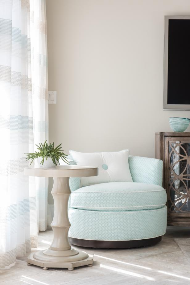 Neutral Contemporary Sitting Room With Light Blue Armchair