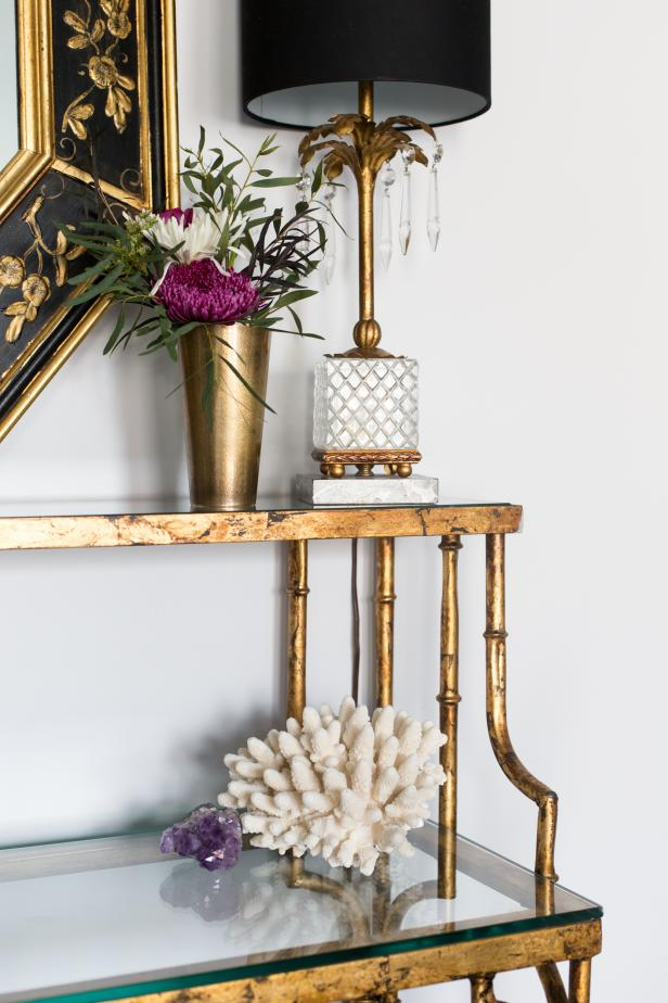 Gold Shelf With Palm Tree Table Lamp and Gold Flower Vase