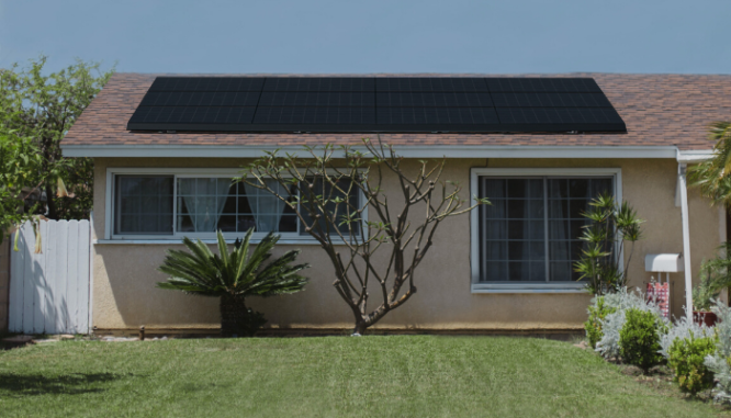 A house with solar panels on it, which you could get money back in taxes for.