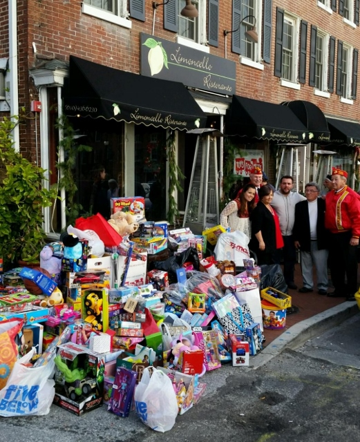Mingrino Family, owners of Limoncello, with all of the toys donated
