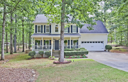 New List | Family Home with Rocking Chair Front Porch