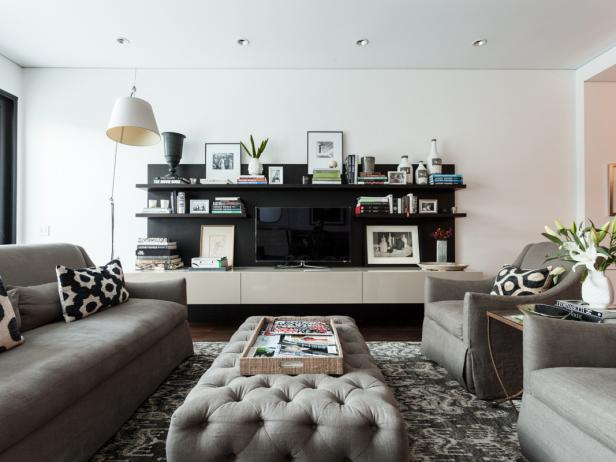 Contemporary White Living Space With Gray Furniture, Black Shelving