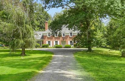 Custom Brick Home Nestled on a 22+ Acre Equestrian Estate