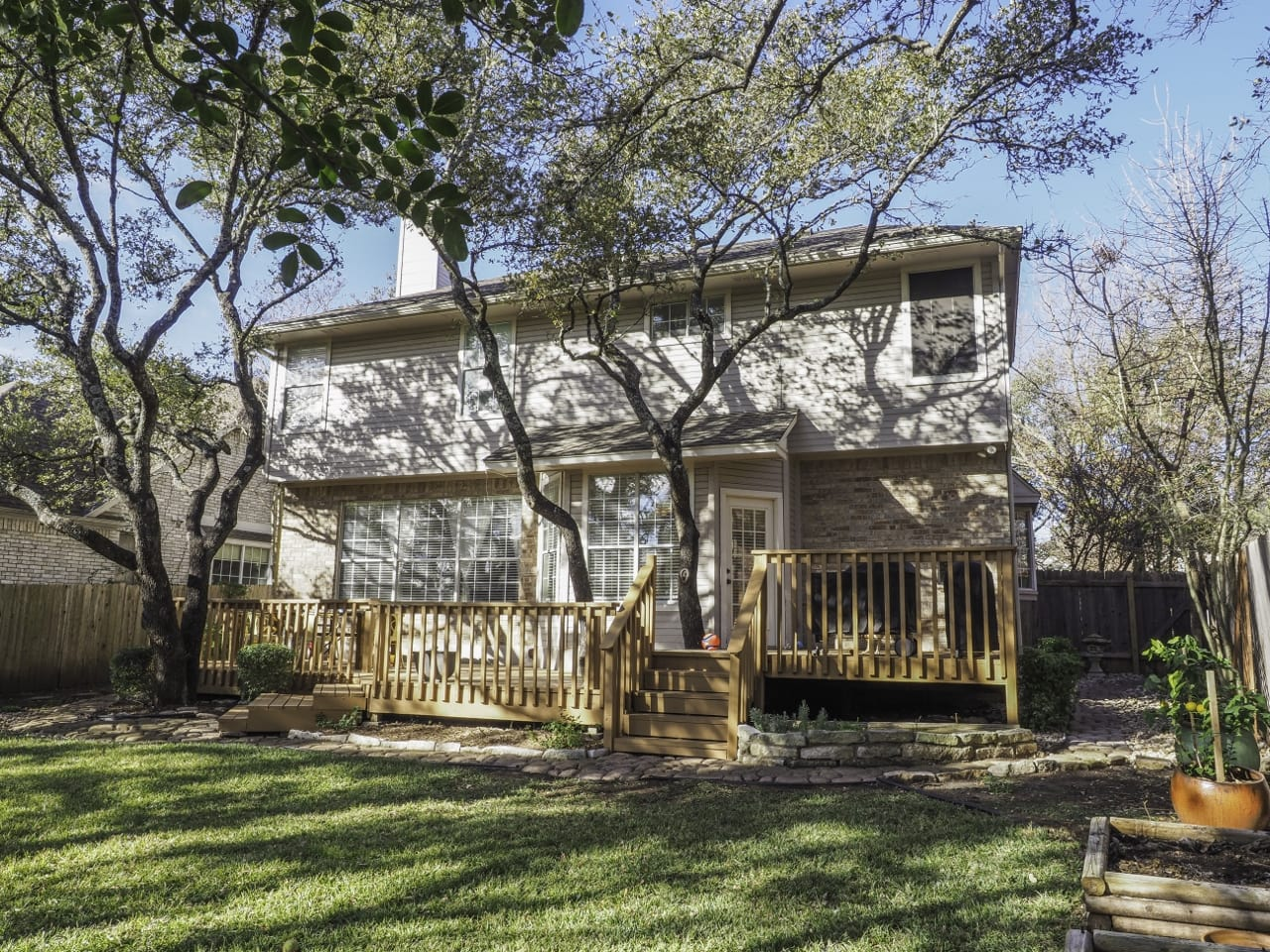 wrap around porch on a beautiful lot on Canyon Creek