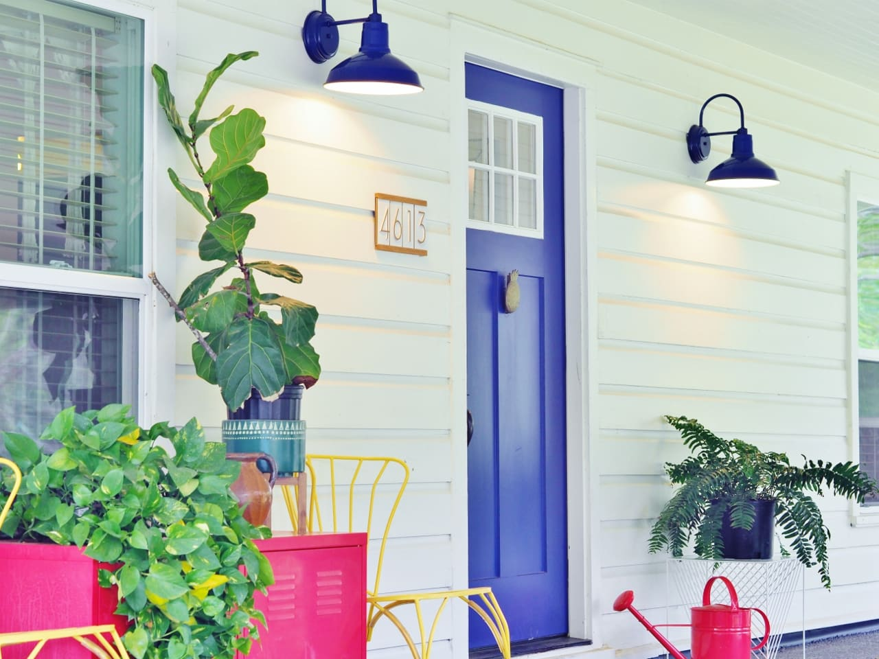 Paint the exterior an appealing color like this blue front door