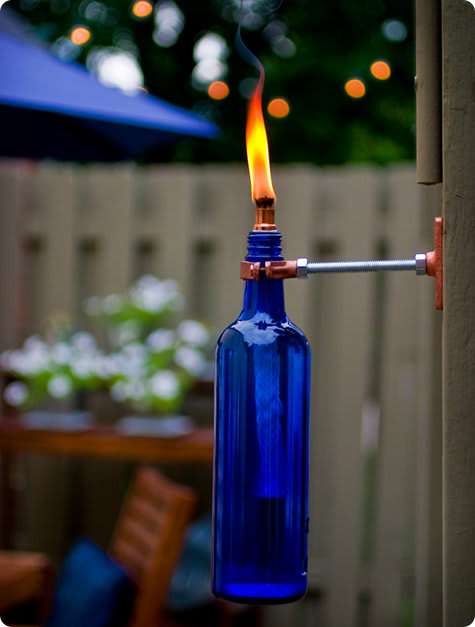 Light up some wine bottle tiki torches